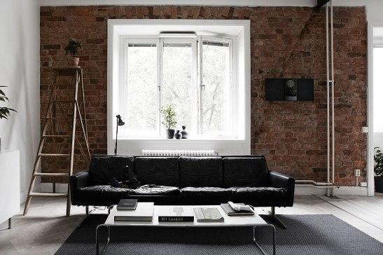 Soffa tegel vägg vardagsrum Långholmsgatan