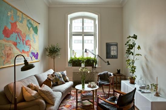 Vardagsrum soffmöbler fönster Bastugatan