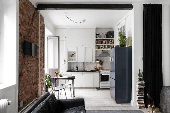 Kök tegel vägg matbord kylskåp Långholmsgatan