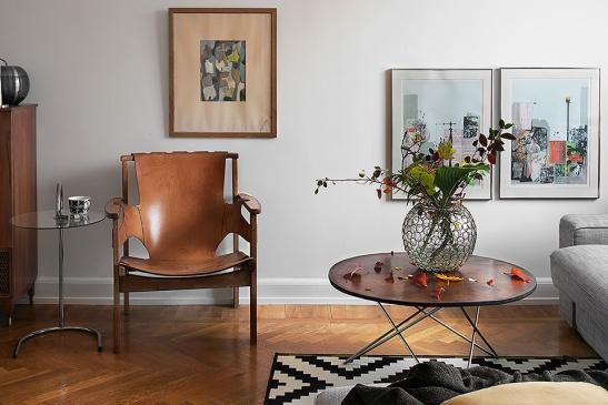 Skinnfåtölj konst vas vardagsrum