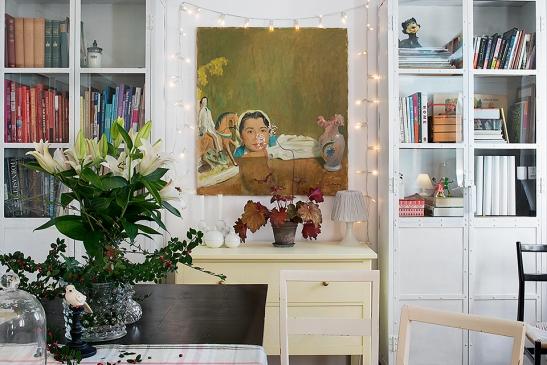 Blomma bokhylla konst