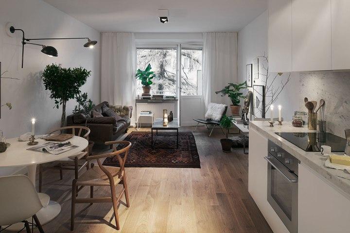 Vardagsrum köksbord fönster soffmöbler matta