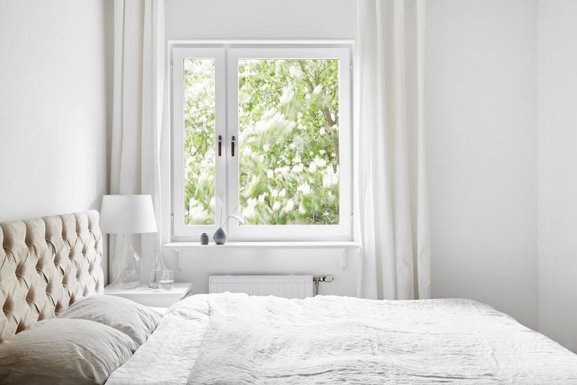 Södermalm bedroom white beige bed linen
