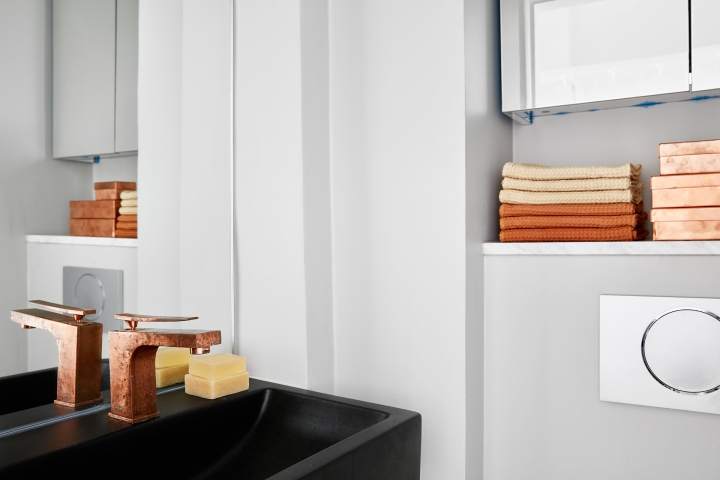 Östermalmsgatan bathroom orange rust copper black white Fantastic Frank