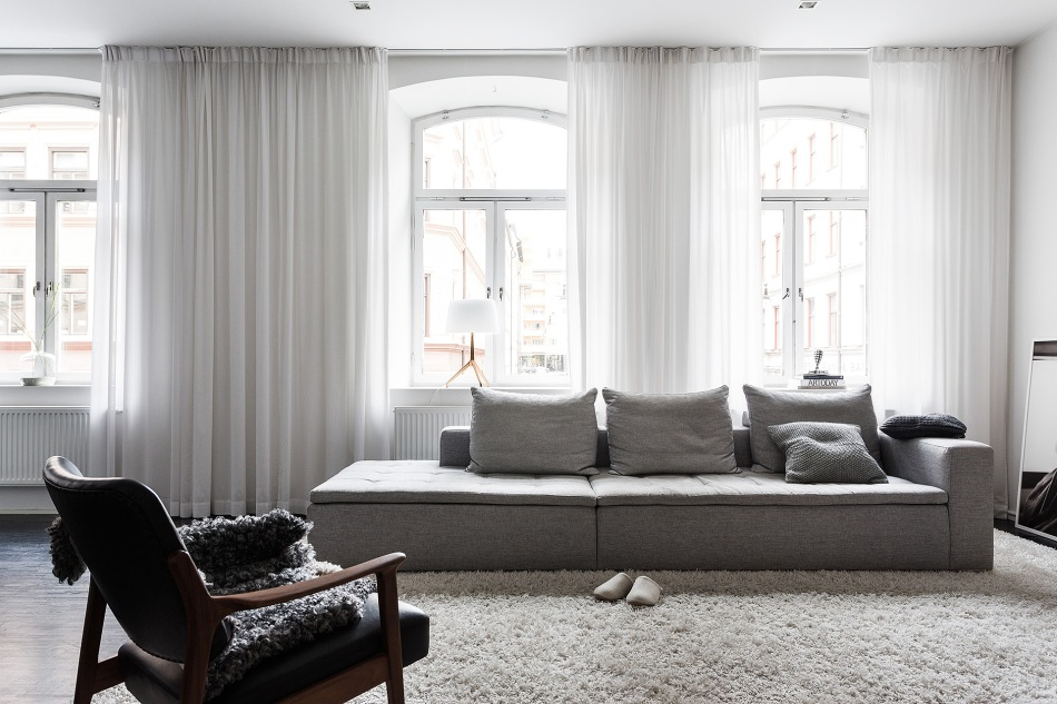 Norra Agnegatan Kungsholmen Black white livingroom armchair carpet curtains windows Fantastic Frank